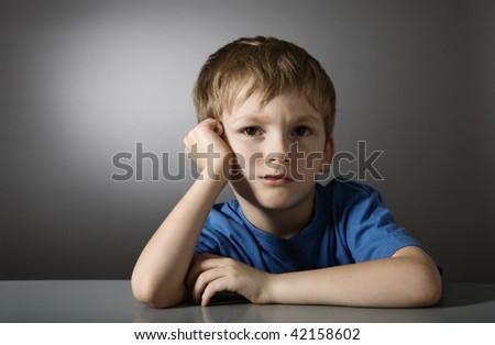 Tired sad child - stock photo