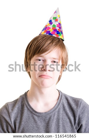 Tired sad teenager in a festive hat. Portrait on a white background