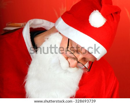 Tired Santa Claus sleep on the Red Background closeup