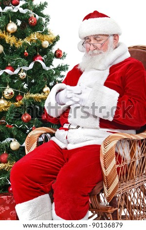 tired Santa Claus sleeping in his rocking chair, isolated on white background - stock photo