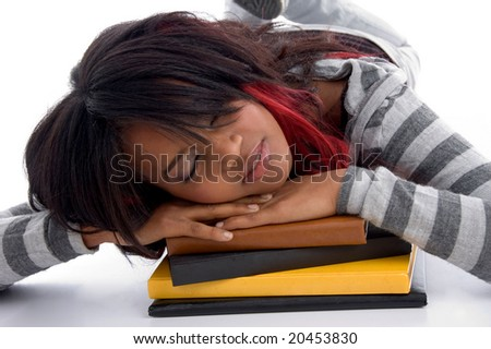 tired school girl sleeping with her books against white background - stock photo