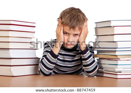 Tired schoolboy isolated on a white background