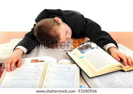 tired schoolboy lying and sleeping on the books - stock photo