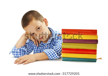 Tired schoolboy with learning difficulties. Isolated on white background - stock photo