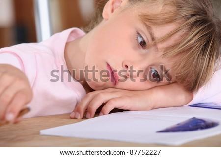 tired schoolgirl - stock photo