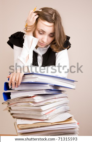 Tired secretary with a lot of documents - stock photo