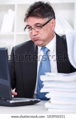 Tired senior Businessman having lot of work - stock photo