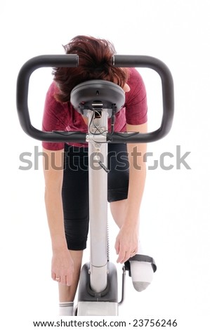 Tired senior woman on bicycle - isolated - stock photo