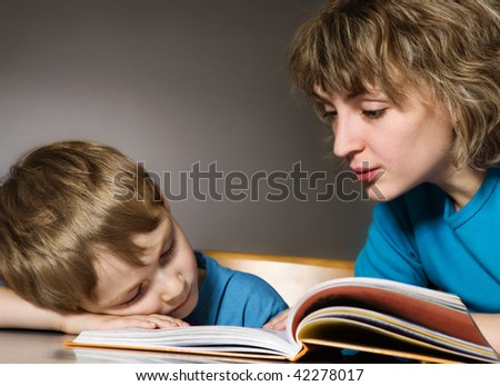 Tired son and affectionate mother - stock photo
