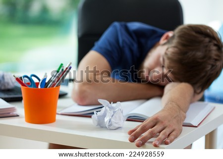 Tired student fall asleep during preparation to exams   - stock photo