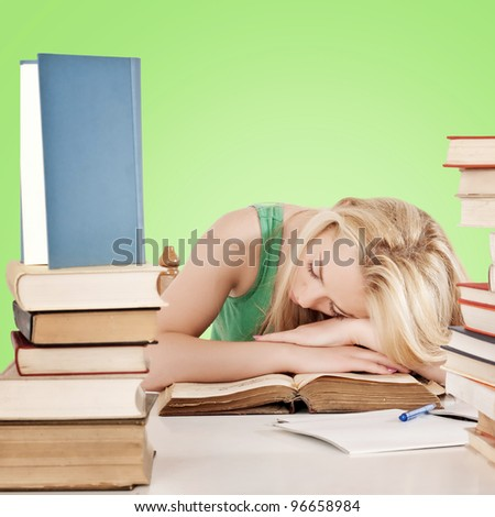 Tired student fell asleep on books - stock photo