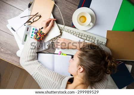 tired student girl with books and coffee sleeping on the table. education, session, exams and school concept . studying hard. Top view - stock photo
