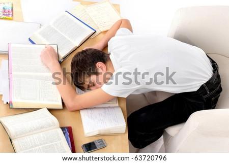 tired teenager lying and sleeping - stock photo