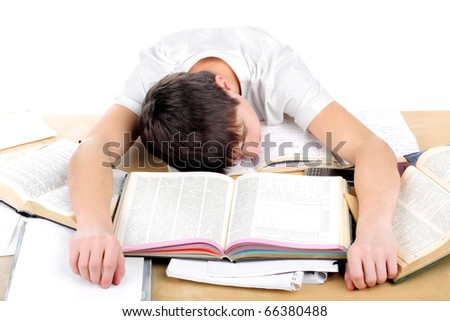 tired teenager lying and sleeping on the books - stock photo