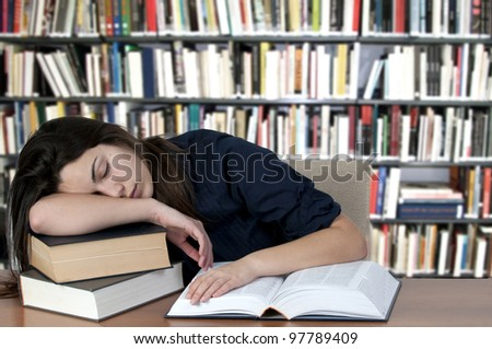 Tired teenager, sleeping on the books - stock photo