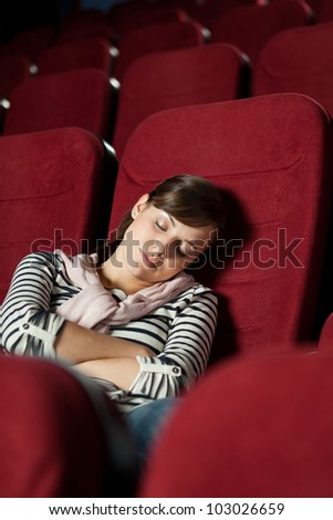 Tired woman  after the  movie - stock photo