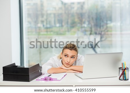 tired woman lying on her office, stressed at workplace - stock photo