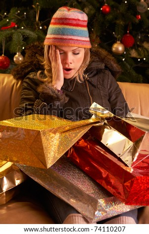 Tired Woman Returning After Christmas Shopping Trip - stock photo