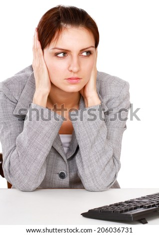 Tired woman sitting on the desk, isolated white background - stock photo