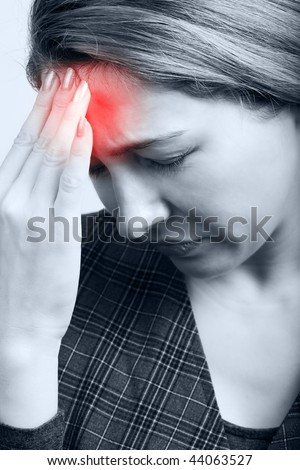 Tired Woman Suffering from Headache - stock photo