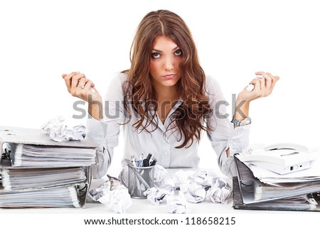 Tired woman with documents on her office - stock photo