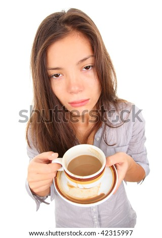 Tired woman with empty and bored eyes looking at the camera having spilled a little coffee. Beautiful mixed race asian / caucasian model isolated on white background. - stock photo