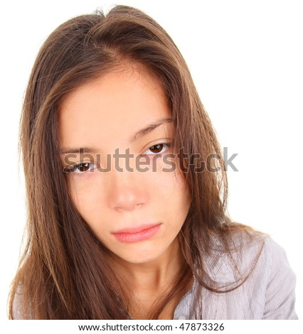 Tired woman with empty and bored eyes. Mixed race asian / caucasian model isolated on white background. - stock photo