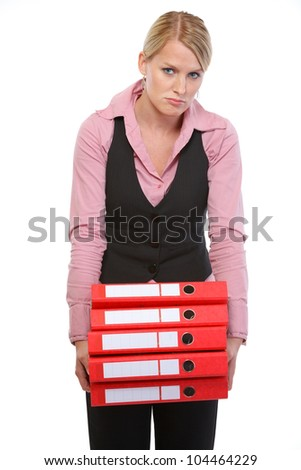 Tired woman with stack of folders - stock photo