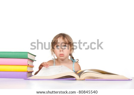 Tired young adorable, pretty little girl, 4 year child with brunette hair, unhappy bored lying on on a stack of books, isolated over white background. - stock photo