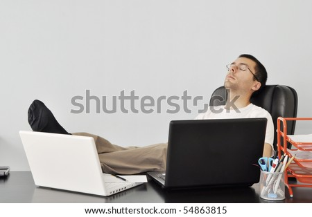 Tired young businessman - stock photo