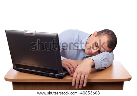 Tired young businessman asleep at his desk isolated on white background - stock photo