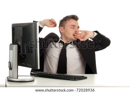 tired young businessman in black suit with computer - stock photo