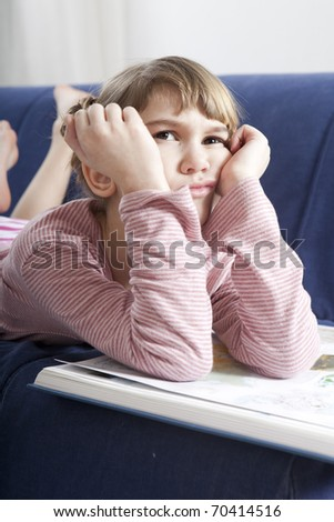 Tired Young Girl dont want to read  book - stock photo