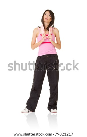 Tired young girl of fitness holding towel, full length portrait isolated on white background. - stock photo