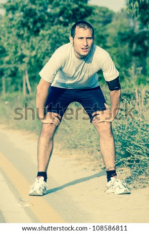 Tired Young Man After Jogging - stock photo