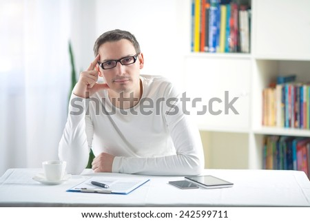Tired young man sitting at the desk