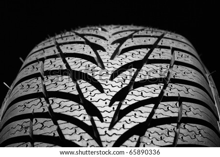 tires on a black background - stock photo