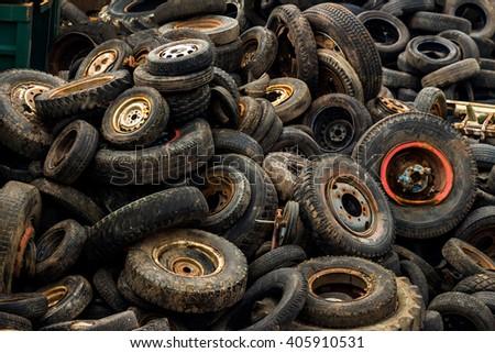 tires on junkyard - stock photo