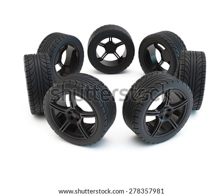 tires stand on light-alloy wheels round a blank space - stock photo