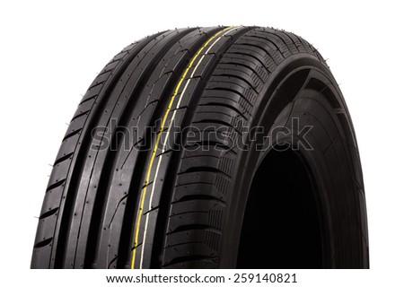 tires with asymmetric tread on a white background - stock photo