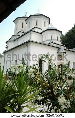 TISMANA, ROMANIA - AUGUST 21, 2008: The newly renovated Tismana monastery, one of the oldest religious landmark in Romania is visited every year by orthodox pilgrims - stock photo