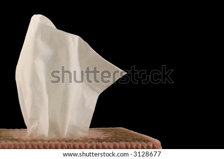 Tissue Box - black background - close-up of paper handkerchief in a decorative plastic canvas box. - stock photo