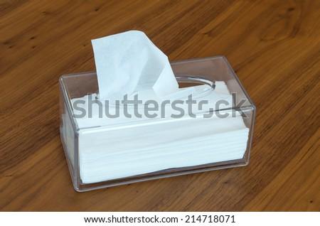 Tissue box on wood background - stock photo