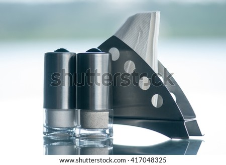 Tissue holder with salt and pepper bottle in restaurant table