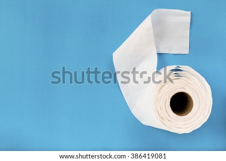 Tissue paper roll on the blue background.