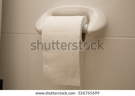 Tissue roll in the toilet home. - stock photo
