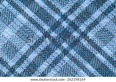 tissue, textile, cloth, fabric, material, texture. Textile  blue cell.  cloth, typically produced by weaving or knitting textile fibers. - stock photo
