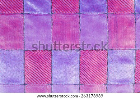 tissue, textile, cloth, fabric, material, texture. Textile red blue cell.  cloth, typically produced by weaving or knitting textile fibers. - stock photo