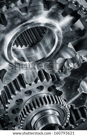 titanium and steel power gears in blue - stock photo