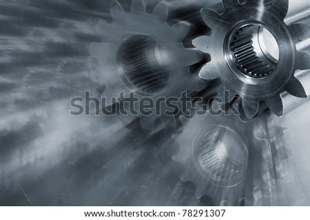 titanium gears, wheels against steel, technology concept with slight zoom effect, movements.